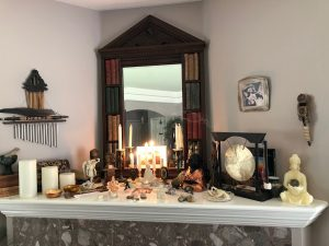 Alter above fireplace with mirror and candles