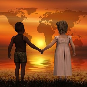 Young Boy Holding Young Girl's Hand
