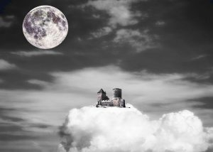 A castle sitting on a cloud with the moon in the background.. black and white image
