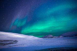 Aurora borealis with green and blue hues