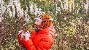 lady with red jacket smelling nature