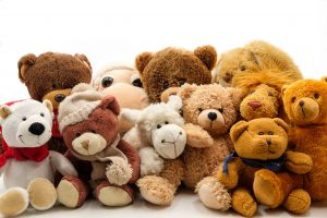 a pile of different types of teddy bears