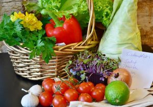 basket and table full of colourful vegetables