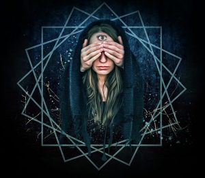 lady with a 3rd eye and someone hands over her two eyes