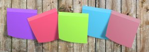 5 different coloured post-it note pads