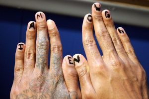 """someone extending their dirty bruised hands, showing marker letters on their fingernails """"I am enough"""""""