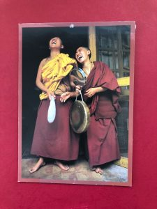 two Tibetan nuns laughing