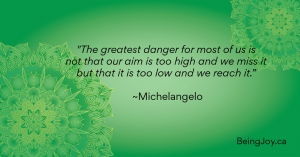 """Quote over green mandala - """"The greatest danger for most of us is not that our aim is too high and we miss it but that it is too low and we reach it."""" ~Michelangelo"""