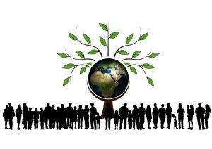 silhoutte of dozens of people surrounding a globe on a pedestal with a tree growing out the top.