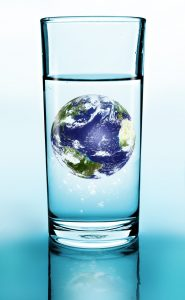 Galss of water with an image of the planet floating in it